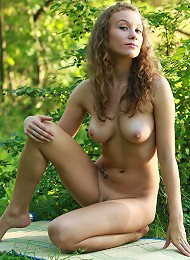 Curly Haired Blonde With Natural Firm Breasts Posing Naked In The Wood