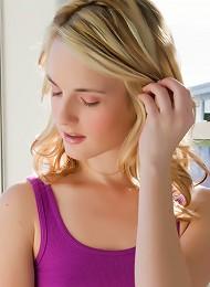 Glamorous Teen Model Sara James Posing By The Window In Her Purple Dress Spreading Her Legs
